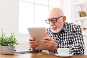 Salt-Manage-Senior-Online-Elderly-Man-On-Tablet