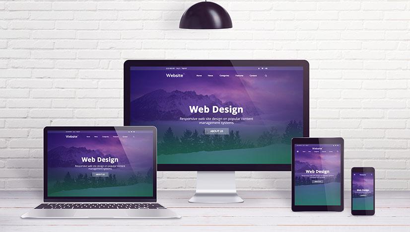 Desktop screen, laptop, tablet and smartphone displaying responsive website design