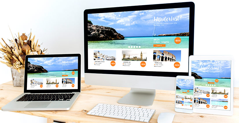 Desktop, laptop, tablet and smartphone all showing website design for travel website